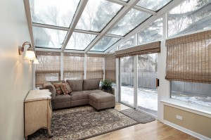 Family room with skylights and door to back yard