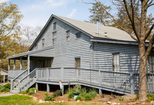 grey wood siding house with a wheelchair accessible ramp