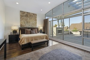 Master bedroom in luxury home with large deck