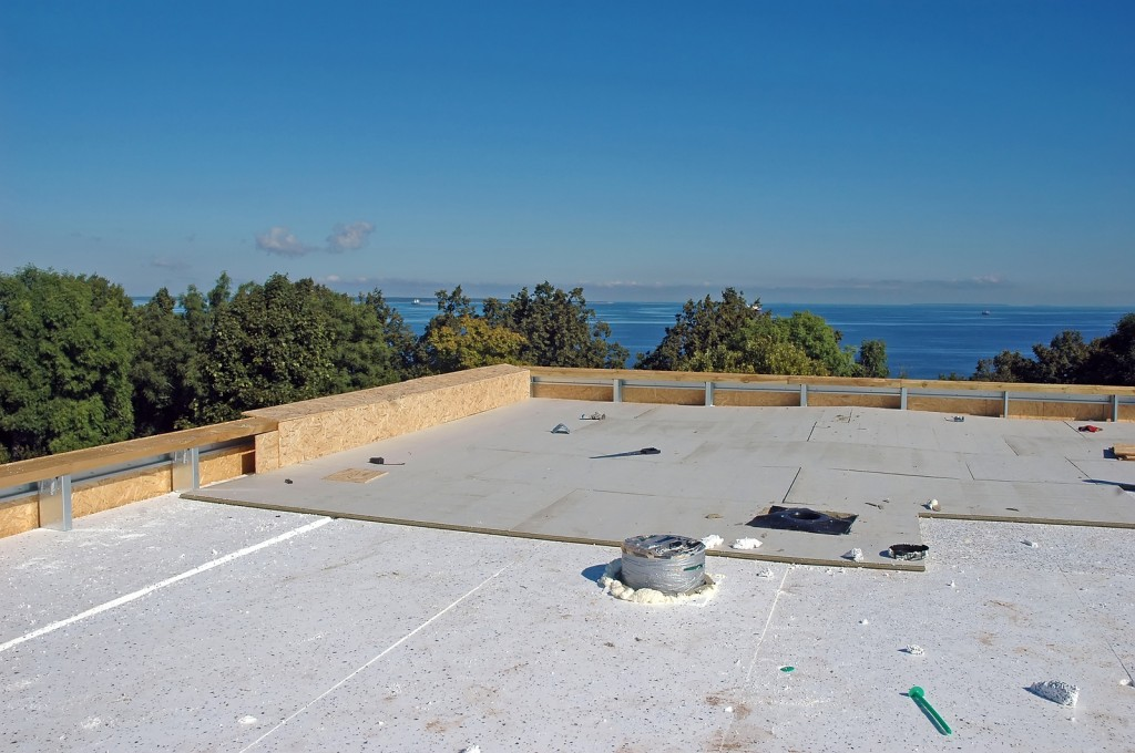 Water damage to your rooftop deck get repairs done right for Flat roof waterproofing paint