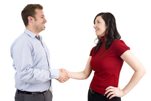 Man and woman business casual shaking hands