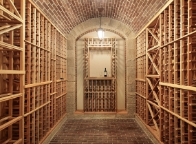 Wood wine cellar with brick ceiling