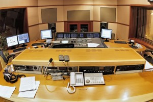 A shot of a professional recording studio, complete with technic