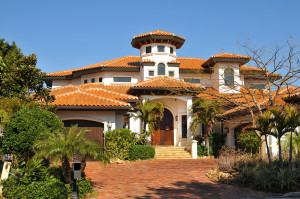 Traditional spanish home with tiles roofs. Tower hints of Queen Anne style. Arched porch and rough hewn doorway support the main spanish theme of the residence.